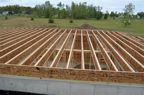 Build A House Website basement framing and floor joist work continues davidson