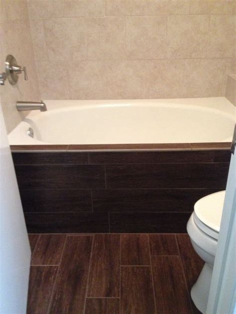walnut bathroom flooring dark walnut wood tile floor and bathtub face contrast