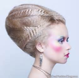 This victorian beehive hairdo it looks ideal with classic make up