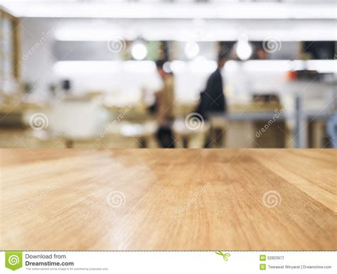 table top  blurred people  kitchen background stock