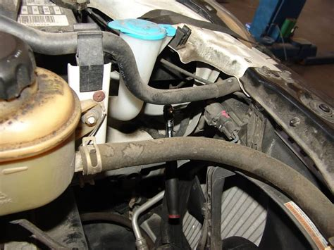 Suzuki Reno Headlight Assembly by 2005 Suzuki Forenza Changing The Low Beam Headlight Bulb