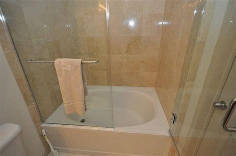 Tub Shower Combo Glass Doors Bathroom Soaker Tub Shower Combo With Folding Glass Door Design For Bathtub Shower Designs