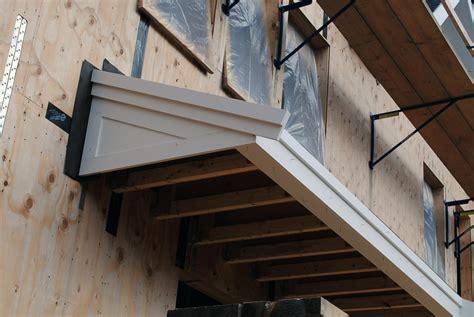 front door roof overhang 301 moved permanently