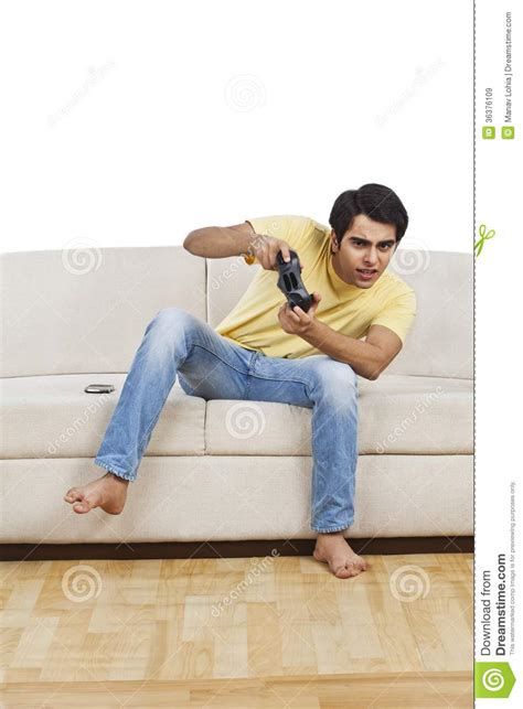 couch sitting man playing video game stock image image of clothing