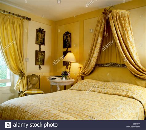 coronet bed drape coronet with patterned yellow drapes above bed with pale