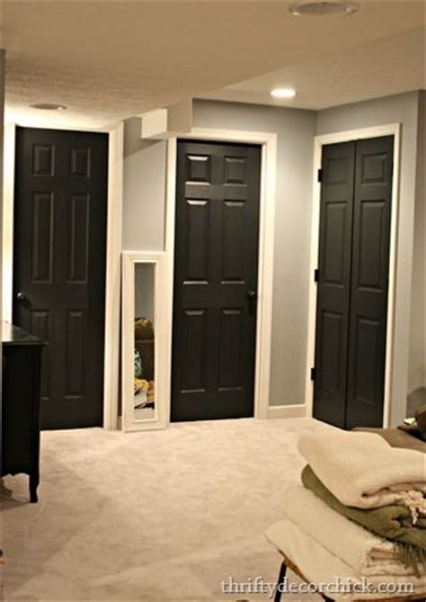 grey house interior black interior doors white trim through out house grey walls white trim hall