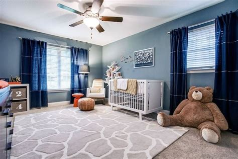 Amazing Boy S Nursery Features Blue Walls Accented With Navy Blue Curtains For Nursery