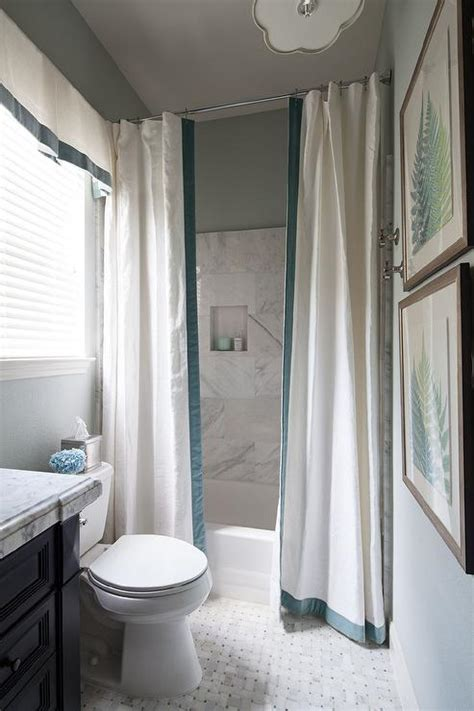 drop in shower with two shower curtains accented with