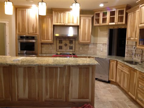 Kitchen Cabinets And Granite Countertops by Kitchen With Hickory Cabinets And Travertine Backsplash