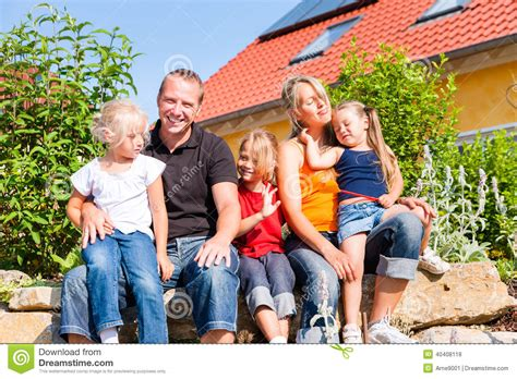 Family Nsun family in front of home or house stock photo image 40408118