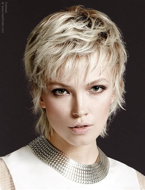 very short feathered hair cuts short blonde hair that falls forward to surround the face