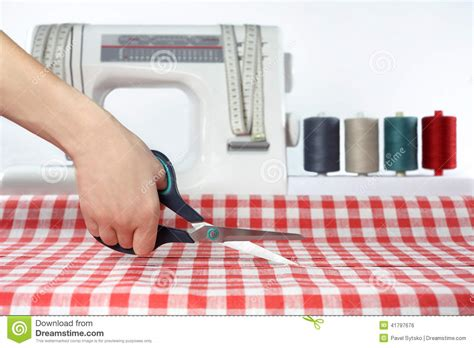 sewing and cutting tailor sewing cutting fabric dressmaker at work fabric