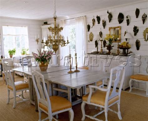 ac081 07 wooden table and white wood gustavian chairs