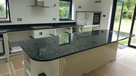 Pictures Of Kitchen Countertops And Backsplashes emerald pearl granite kitchen countertop with backsplash