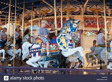 kingdom merry boy the merry go carrousel in the magic kingdom at stock photo royalty free