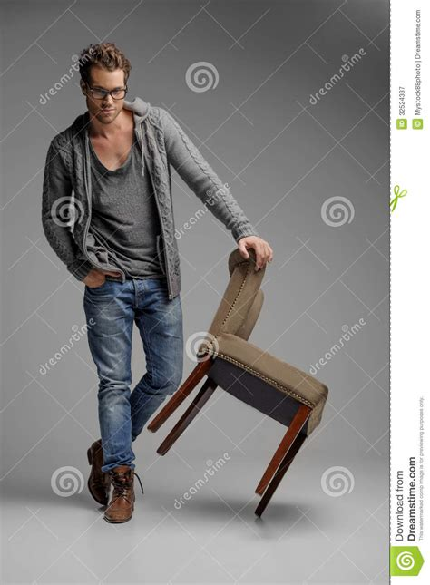 Standing Leaning Chair by Handsome With Chair Handsome In Glasses Leaning