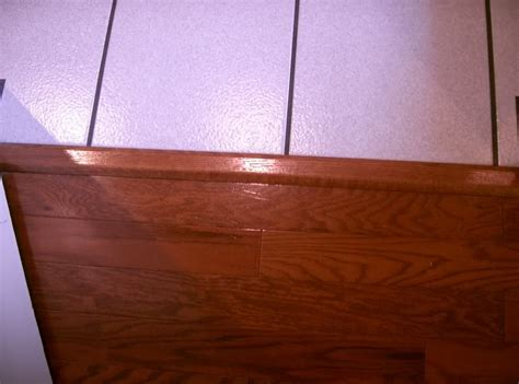 tile to wood floor transition ideas homesfeed cream color tile to wood floor transition ideas homesfeed
