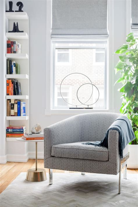 good Grey And Orange Living Room #5: 03-A-cozy-reading-nook-by-the-window-features-an-upholstered-chair-a-small-side-table-and-an-IKEA-bookshelf-in-the-corner.jpg