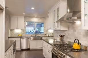 white kitchen shaker cabinets cemento quartz counters