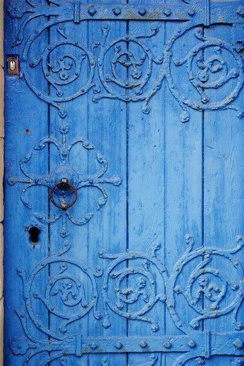 beautiful blue color indigo door with elaborate old hardware burst of blue