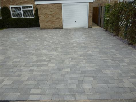 this large modern block paved driveway was created by awbs landscaping in oxford using brett