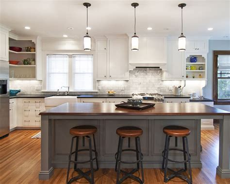 white kitchen island with seating white kitchen cabinets bay window pendant lights