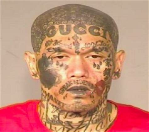 gang tattoo fail gang member with gucci tattoo on his forehead captured in
