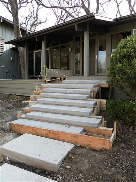 Exterior Concrete Cantilevered Stair Frontal building floating concrete steps garden and landscape outdoor living middle and