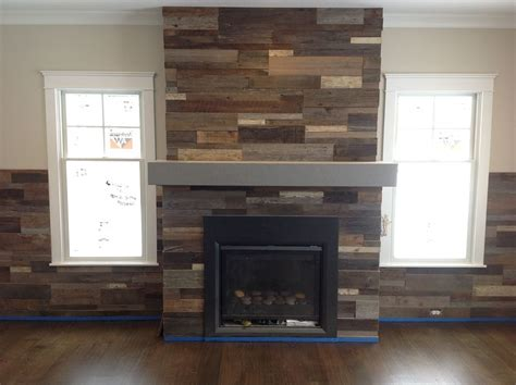 reclaimed wood and stone fireplace wall pictures of fireplace made with pallets in chevron pattern
