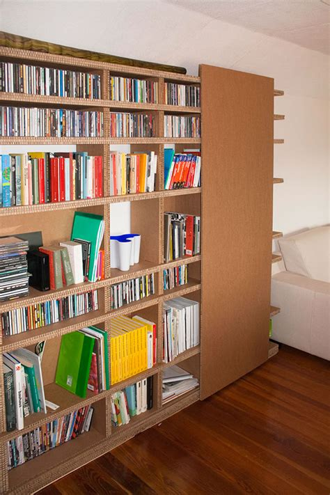 slide cardboard bookshelves on behance