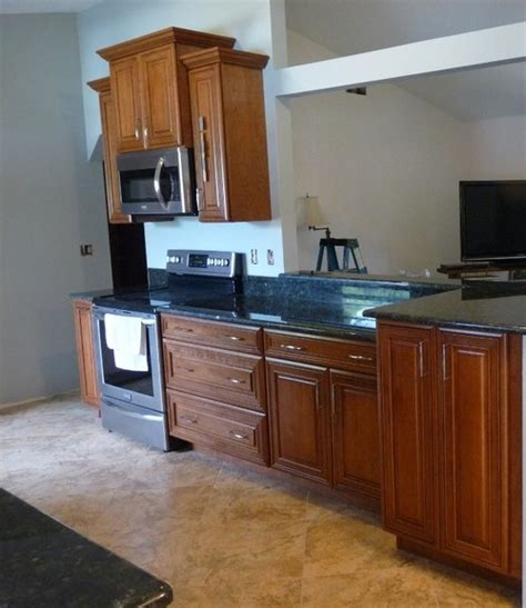 what wall color goes with medium cherry cabinets and toffee leather furniture with mixed golden