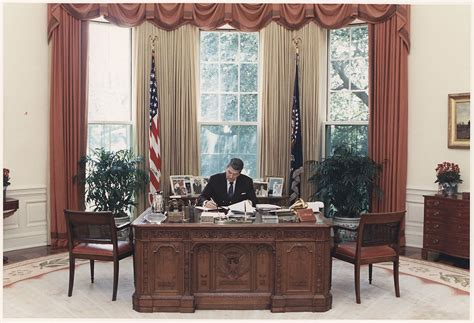 reagan oval office file photograph of president reagan working at his desk in