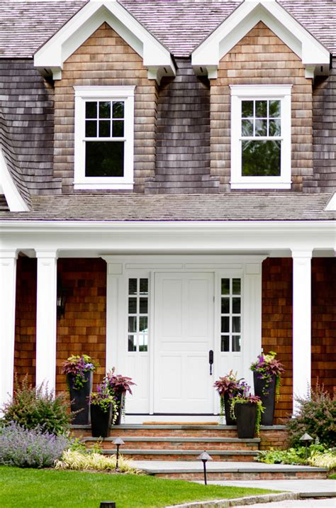 front entry classic beach house with elegant interiors home bunch