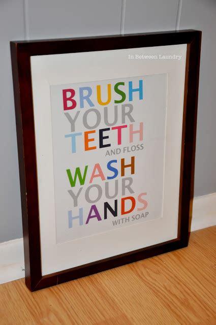 free bathroom printable art in between laundry easy bathroom art