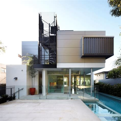 architectural house house with outdoor spiral staircase leading to rooftop