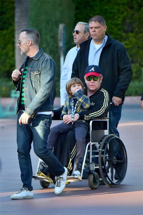 Elton John spotted in wheelchair on family trip to