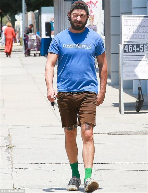 shia labeouf shows off some interesting tattoos just above