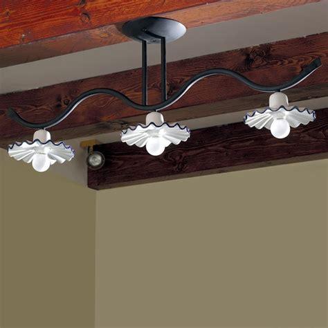 illuminazione taverna ladario da soffitto rustico ferro e ceramica