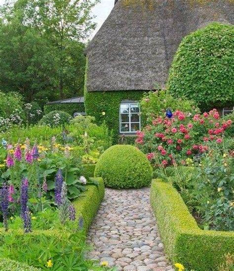 cottage garden design with hedges and stone path the