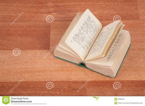 care of wooden floors a novel books opened book on floor stock photography image 4386042