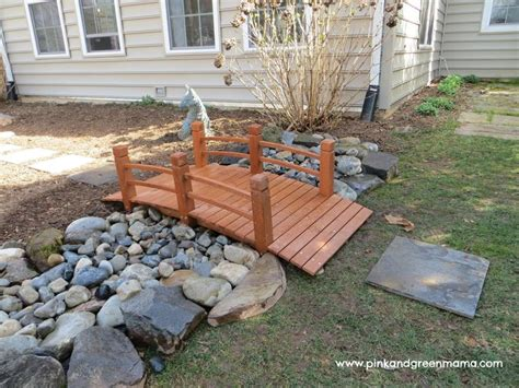 diy river bed diy backyard makeover on a budget from pink and green river bed bridge and