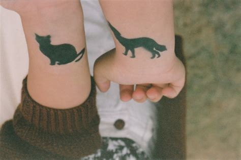cat tattoo buzzfeed 74 matching tattoo ideas to share with someone image