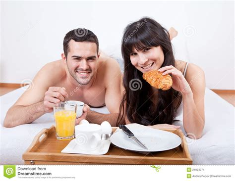 eating in bed young couple eating breakfast in bed stock images image