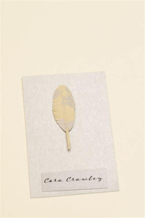 diy name cards diy feather motif menu and escort cards