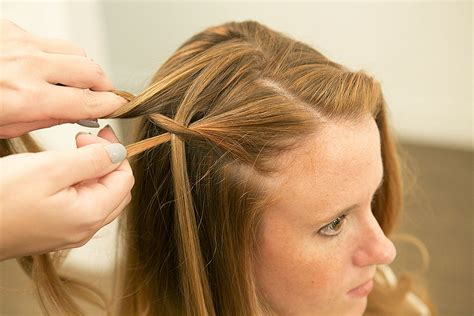 how to section hair for braids take the bottom section of hair and pull it over the