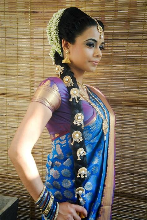 traditional hair traditional indian bride wearing bridal saree and