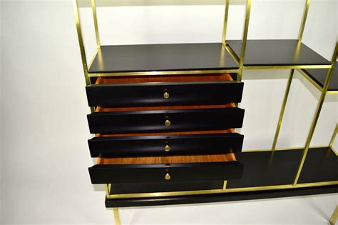 etagere 8 cases but brass and wood etagere by furnette at 1stdibs