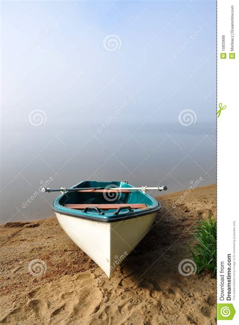 the white of pond bank books white boat on the banks of a pond royalty free