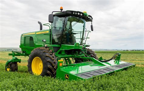 new john deere combine developments for 2015 john deere introduces new windrower for 2015 tractor com