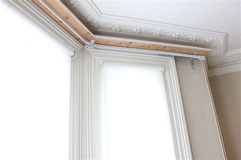 putting up curtain rail how to put up a curtain pole on bay window curtain